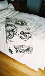 Toile garment bag on bed